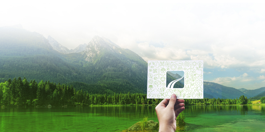 image of hand holding card with window to scenic landscape in the background